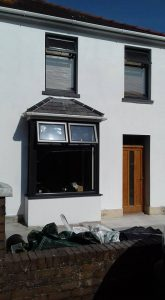 Pauls Plastering - New roof over bay window, new smooth render finish and painted.