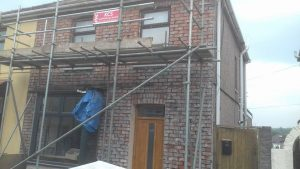 Pauls Plastering - Render removed to reveal bare brick